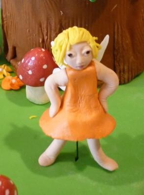 Orange fairy, akimbo