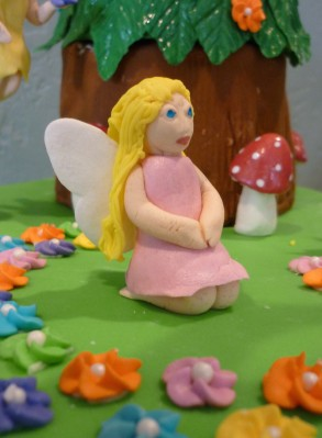 Pink fairy, kneeling